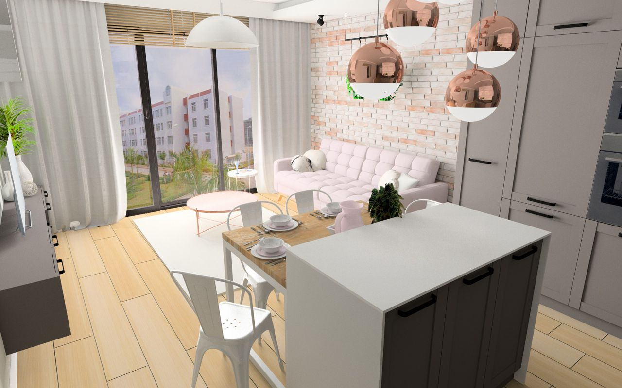 Salon z wyspą jadalnianą, z szarymi meblami i różową sofą Fiord marki Sweet Sit. W tle duże okno sięgające podłogi.