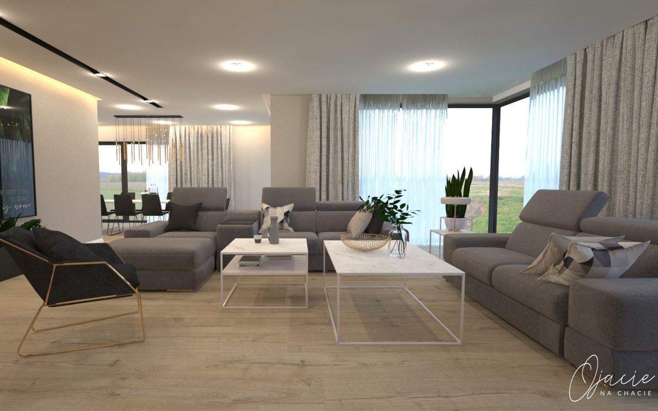 Narożnik w kształcie litery L i sofa Plaza marki Gala Collezione w dużym salonie, z dwoma białymi stolikami i fotelem